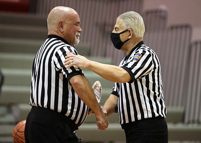 PIAA referee  Art Monteleone (right) was honored at Moniteau High School Saturday for his 50 serving as a basketball and football official. The district threw a surprise ceremony prior to a girls basketball game. Seb Foltz/Butler Eagle 02/20/21