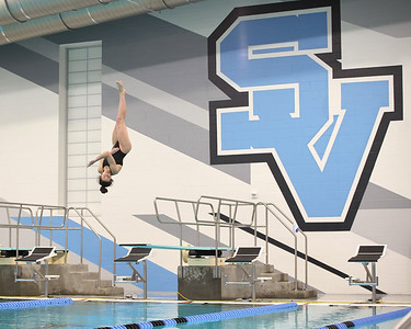 Seneca Valley diver Riley Smith competes against Butler in the new Seneca Valley School District pool during the venue's inaugural event Thursday. Seb Foltz/Butler Eagle 02/19/21