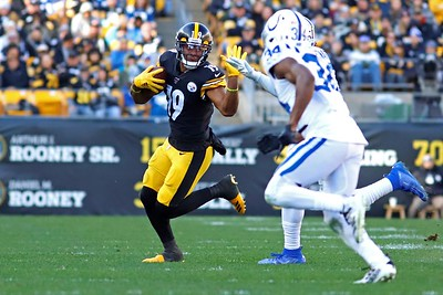 Steeler wide reciever JuJu Smith-Schuster puts up a stiff arm to hold of a Colts defender in the third quarter. The play resulted in an unnecesary roughness call on the Colts after Schuster was pushed out of bounds. Seb Foltz/Butler Eagle