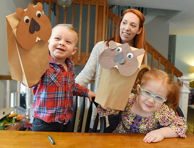 Wesley Boland, 2, and his sister, Emilia, 4, show off their groundhog hand puppets that they made with the help of their mother, Caitlyn Boland, Mars Library director. Friday, January 29, 2021. Harold Aughton/Butler Eagle.