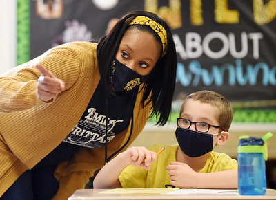 Third-grade teacher, Krystal Epps-Abdulhafith assists Chase McDade with his Martin Lutheran King project at Emily Brittain Elementary Friday, January 15, 2021. Harold Aughton/Butler Eagle.