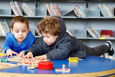 Luca Colella(right), 3, and Owen Pawlowicz,4, work on a puzzle in the children's section of the Cranberry Library Tuesday. Seb Foltz/Butler Eagle 01/07/12