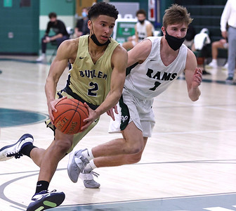 Butler's Devin Carney drives the lane against Pine Richland's Eli Jochem Tuesday. Carney scored his 1,000th point in the 65-61 road loss. Seb Foltz/Butler Eagle 01/19/21