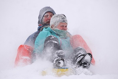 Adam Rathfon of Cranberry steers his sled with his daughter Teagan,10, Saturday at North Boundary Park. With temperatures in the high teens and low 20s area residents still took advantage of fresh snow the day after Christmas. Seb Foltz/Butler Eagle 12/26/20