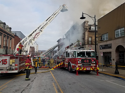 """""""An estimated 80 firefighters assisted in stopping flames that broke out in Sir Speedy Saturday. Main Street was closed from Jefferson Street to about West Wayne Street for most of the day to accommodate emergency vehicles and first responders.""""Photo by Samantha Beal."""