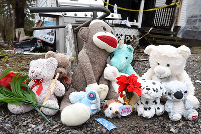 Friends, and neighbors made a make-shift memorial in memory of Tristan Oesterling, 2, who died New Years eve after his family's home caught on fire on Knox Avenue in Butler. Harold Aughton/Butler Eagle.
