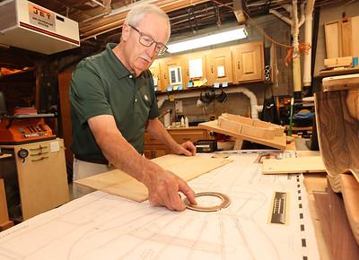 Custom guitar maker Gary Neyman shows how he uses design prints to measure parts of a guitar. Seb Foltz/Butler Eagle 07/07/21