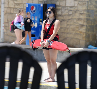 Lifeguard Grace Lanberto of Butler watches over the Alameda Pool Wednesday afternoon. Harold Aughton/Butler Eagle