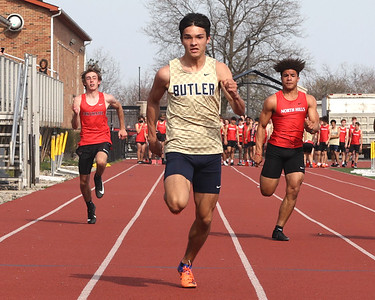 Butler's Guinness Brown pushes to the finish line to win the 100 meter in Thursdays home track meet against Fox Chapel and North Hills. Brown set the school record for the event finishing in 10.54 seconds. Seb Foltz/Butler Eagle 04/08/21