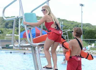 Lifeguards Olivia Crunick, 18, of Cranberry, and Alec Malichky, 16, of Cranberry, switch shifts at Cranberry Township Community Waterpark. PHOTO: JULIA MARUCA