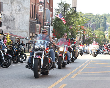 Eric Mershimer, presdient of the Butler chapter of Alliance of Bikers Aimed Towards Education leads riders down Main St. to kick off Butler Bikes & BBQ  Thursday. Seb Foltz/Butler Eagle 07/22/21