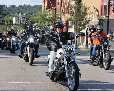Motorcycle riders cruise Main St. during Thursday's parade  to kick off this weekend's Butler Bikes & BBQ at the Butler Farm Show. This is the event's inaugural year. Seb Foltz/Butler Eagle 07/22/21