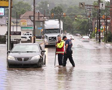 Butler city firefighters assist a stranded motorist on New Castle Street Wednesday. Seb Foltz/Butler Eagle 06/09/21