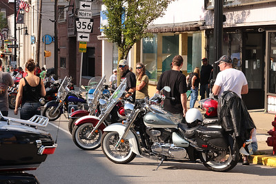 Riders get ready for the Main St. motorcycle parade Thursday to kick off this weekend's Butler Bikes & BBQ at the Butler Farm Show. Seb Foltz/Butler Eagle 07/22/21