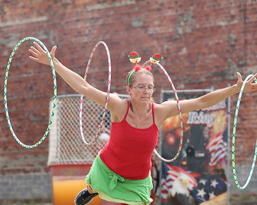 Mandy Williams of Harrisville shows off her hoolahoop skills during Christmas in July festivities on Main St. in Butler Saturday. Seb Foltz/Butler Eagle 07/24/21