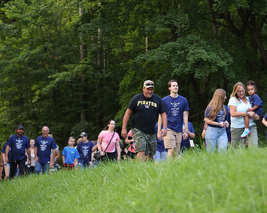 Walkers make their way around the loop in Butler's Memorial Park Saturday during a memorial service for Caitlyn Kaufman, the Butler native shot and killed during an alleged road rage incident in Tennessee in November of 2020. Seb Foltz/Butler Eagle 07/24/21