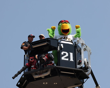 The Pirate Parrot shows his excitement perched atop Cranberry Township Volunteer Fire Department's ladder truck with Chief Scott Garins and Tom Klingensmith. Seb Foltz/Butler Eagle