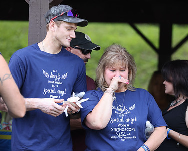 Caitlyn Kaufman's mother Dianne Kaufman holds back tears with her son Tyler during Saturday's memorial service at Butler's Memorial Park Saturday. Seb Foltz/Butler Eagle 07/24/21