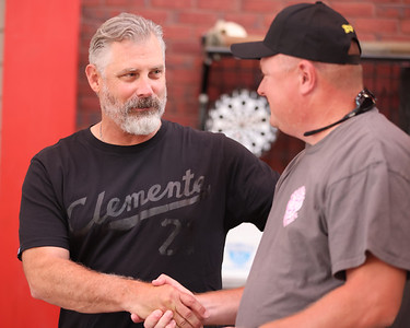 Pirate manager Derek Sheldon shakes hands with Adams Township fireman and former chief Bill Hays Tuesday. Seb Foltz/Butler Foltz 07/27/21