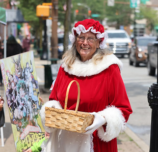 Jean Wagner fills in for Ms. Claus handing out candy to passers by during Christmas in July on Main St. in Butler Saturday. Seb Foltz/Butler Eagle 07/24/21