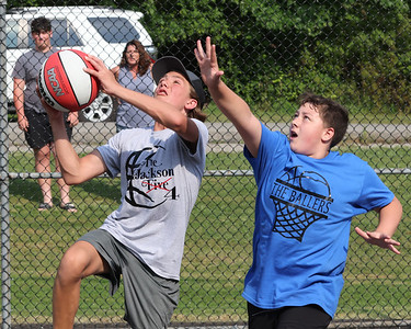 Preston Simko, 14, goes for a layup against Ty DeLess, 12, in Butler's 3-on-3 Basketball tournament Tuesday at Memorial Park. Seb Foltz/Butler Eagle 07/27/21