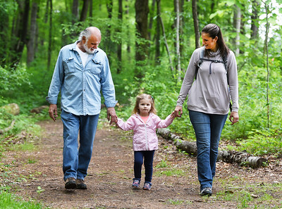 David Chill, left, takes a walk with his granddaughter Addison Chill, 2, and daughter Karen Chill of Meridian, through Preston Park following a re-opening ceremony Tuesday morning. Harold Aughton/Butler Eagle.