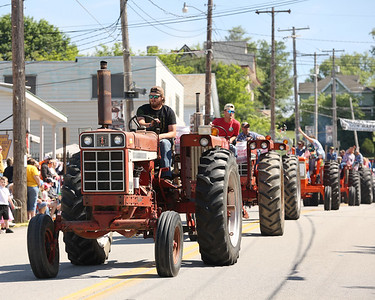 Mitchell McDonald leads a series of tractors down Main St. during Chicora's Memorial Day Parade Monday. Seb Foltz/Butler Eagle 05/31/21