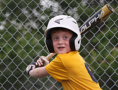 Colton Hickinbottom, 8, takes a swing during Mars youth baseball practice Thursday at the Mars Area School District baseball fields off of Route 228. Seb Foltz/Butler Eagle 06/03/21