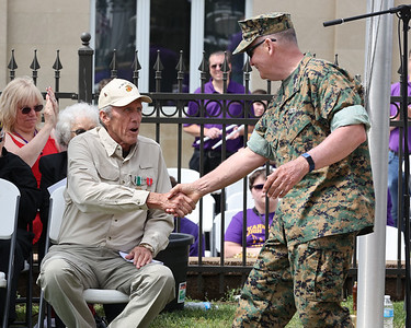Chicora Memorial Day Parade veteran honoree Gary Fennell (seated) shakes hands with retired Lt. General John Sattler during Monday's ceremony in Chicora. Seb Foltz/Butler Eagle 05/31/21
