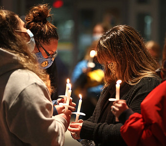 Surrounded by family and friends, Nicole Vickinovac(center) bows her head during a prayer vigil Saturday outside of Passavant Hospital in McCandless. As of Saturday, her husband Greg Vickinovac, an Middlesex Township firefighter, was on a ventilator in the hospital's covid ward. Seb Foltz/Butler Eagle 02/27/21