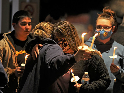 Nicole Vickinovac(center) is consoled by family and friends during a prayer vigil Saturday for her husband Greg Vickinovac outside of Passavant Hospital in McCandless. As of Saturday, Greg Vickinovac, a Middlesex Township firefighter, was on a ventilator in the hospital's covid ward. Seb Foltz/Butler Eagle 02/27/21