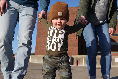 Emmett McGarvey,1, walks on the roof level of the parking garage at Butler Memorial Hospital with his mother and father Megan and Evan McGarvey. A year ago their family tailgated on the roof due to COVID restrictions, while the couple were inside for Emmett's delivery. Seb Foltz/Butler Eagle 03/19/21