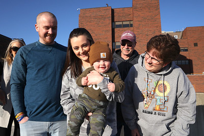 A year after their rooftop birthday tailgate, the family of Emmett McGarvey(center) got together at Butler Memorial Hospital to recount the event. Due to COVID precautions the family had a sort of tailgate while Megan Mcgarvey and Evan McGarvey were in the hospital for the delivery. The family discovered his gender from a sign in the window. Left to right: Father Evan McGarvey, Emmett McGarvey, mother Megan McGarvey, grandparents Brian and Diane McGarvey.   Seb Foltz/Butler Eagle Left to right