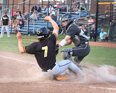 Butler catcher Connor McTighe tags out North Allegheny's Cole Young (7) at home with the bases loaded in the third. Seb Foltz/Butler Eagle 042721