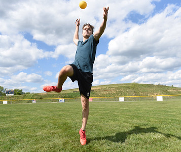 Mason Wirtz, an 11th grader at Mars High School, delivers a serve during a game of spike ball with friends Gabe Singh, Mitchell Mills, Jacob Herbolich and Matt Funk after school Monday afternoon at Adams Community Park. Harold Aughton/Butler Eagle