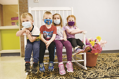 From left to right, Sevren Mesanko, 4, Kingston Titus, 4, Savannah Herbert, 5,and Eleanor McCall, 4, sit on a bench in the lobby of the Early Learning Center at the Butler YMCA on May 7, 2021. The children spoke with the Butler Eagle about their mothers ahead of Mother's Day on Sunday.  Photo By Lauryn Halahurich/Butler Eagle