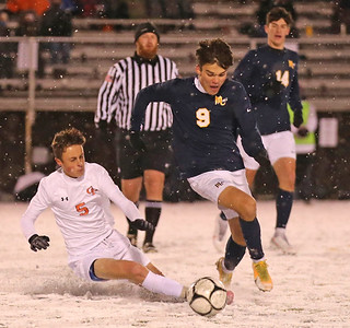Mars' Tyler Nymberg (9) pushes past a slide attempt by Cathedral Prep's Reece Johnson (5). Seb Foltz/Butler Eagle 11/17/20