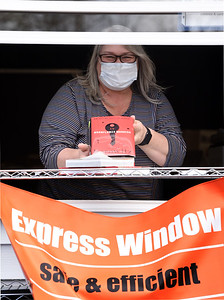 Library director Michelle Lesniak of the South Butler Community Library, stands in front of the library's drive-through window. The library recently closed its doors to walk-through traffic and reopened its drive-through window due to COVID 19. Harold Aughton/Butler Eagle