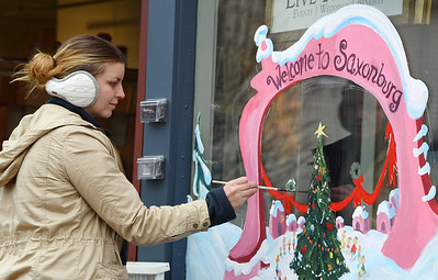 Artist Stephanie Cassidy of Renfrew puts the final touches on a mural she painted on the outside of her storefront in Saxonburg Tuesday afternoon, November 25, 2020. Cassidy and her co-owner, Jaison Schafter recently opened a fine art studio and gallery on main street in Saxonburg. Harold Aughton/Butler Eagle