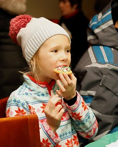 Braelan Richards, 6, of Mars enjoys her freshly decorated Christmas cookie at Shu Brew's Cookie Decoration with Mrs. Claus event during Zelienople's Miracle on Main Street festivities Thursday. Seb Foltz/Butler Eagle
