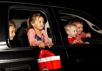 A group of kids talk with Santa at Friday's drive-through Santa's Workshop at Alemeda Park. (Twin sister Lilly and brother Kai, 9, also pictured) Seb Foltz/Butler Eagle