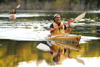 Glade Run Lake Conservancy treasurer T. Lyle Ferderber paddles to shore Thursday evening during the conservancy's food truck night open house at Glade Run. Seb Foltz/Butler Eagle 10/01/20