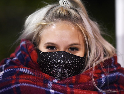 Moniteau's  Emma Barkley, a senior on the dance & drill team bundled up during the game Friday. Harold Aughton/Butler Eagle.
