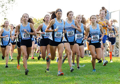 Bailey Royhab (left 408),  Gabby Kutchma (408), and Abby Kreber (407) lead a group of Seneca Valley girls cross country runners in the first heat of Tuesday's home meet. Seb Foltz/Butler Eagle 10/06/20