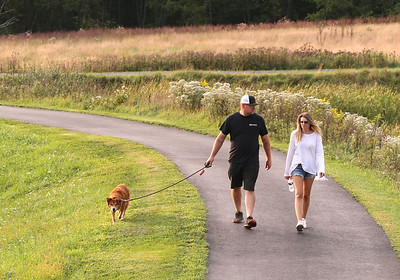 Karl and Kristin Bowser of Butler walk their dog Dove on the trail at Butler County Community College Wednesday evening. Seb Foltz/Butler Eagle 09/16/20