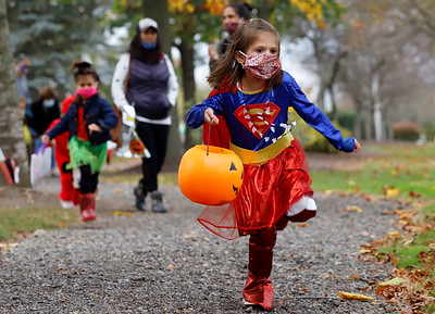 2 in my ftp need captions and resized. Will do when I come in after volleyball. SLUG: 1016_loc_Cranberry Trick or Treat Let's do super girl as the cover secondary if room but that could also go for the trick or treat