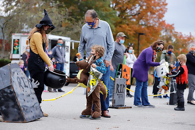 Trick-or-treaters visit socially distanced candy stations in Cranberry Township's Candy Graveyard during their Halloween Outdoor Celebration Thursday. Seb Foltz/Butler Eagle Oct. 15 2020