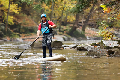 Ian Smith of SurfSUP Adventures warms up for a fall paddle through McConnells Mill State Park Wednesday. Fall Foliage is expected to peak in Butler County this week. Seb Foltz/Butler Eagle 10/21/20
