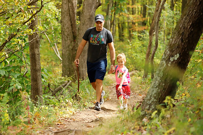 Morraine File Art Fall 2020  Briella Vitalbo, 5, of Zelienople and her dad Mark Vitalbo walk along a section of the North Country Trail along the North Shore of Moraine State Park. Seb Foltz/Butler Eagle  Sept./Oct. 2020
