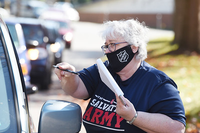 Salvation Army Captain Darlene Means directs traffic Friday afternoon during a food pick up even. Harold Aughton/Butler Eagle